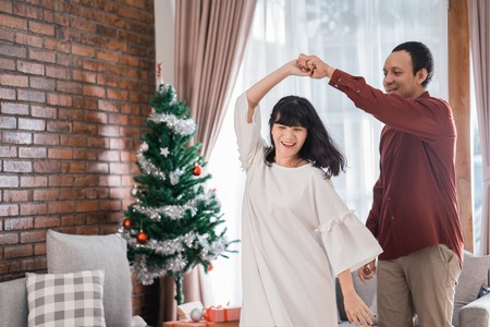 couple loving each other dancing during christmas day