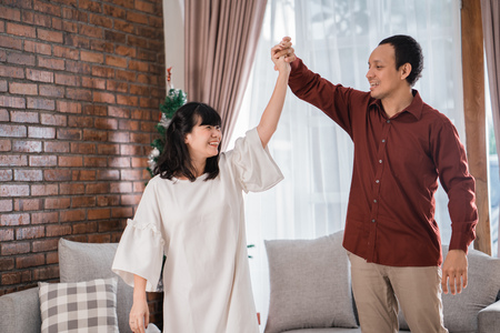 happy asian couple dancing together Stock Photo