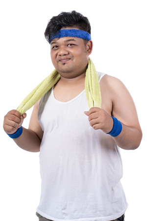 potrait of fat young men sweat after exercising with towel
