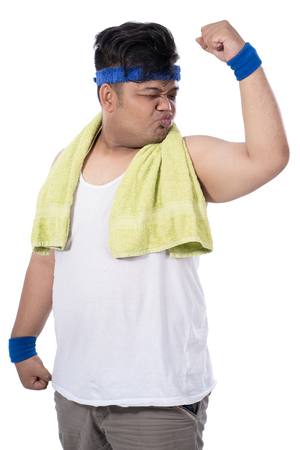 potrait of fat young man with kiss pose to bicep with a towel Stok Fotoğraf