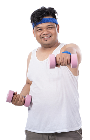 portrait of fat young man doing exercise with dumbbells make punch Stok Fotoğraf