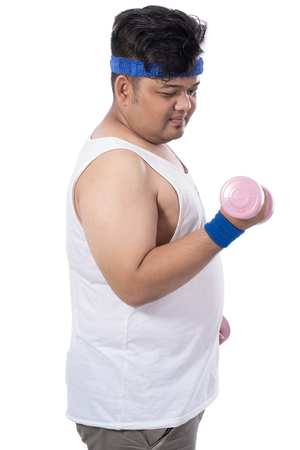 portrait of fat young men with dumbbells