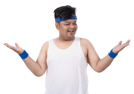 portrait of sporty fat young man raises his hands