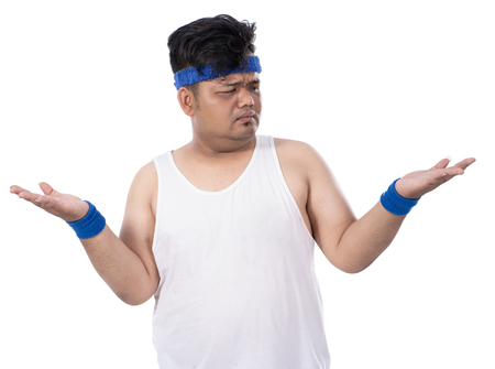 portrait of sporty fat young man raised his hand disappointed
