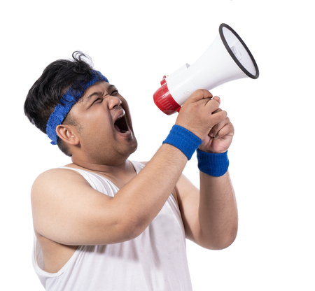 portrait of fat young man open his mouth with megaphone