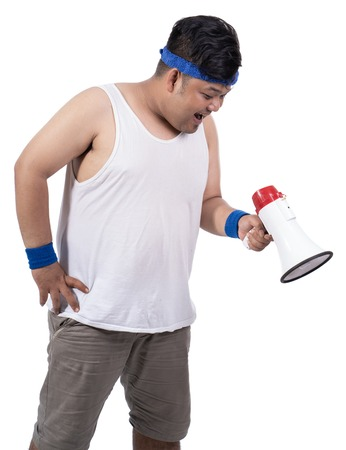 portrait of fat young man open his mouth with megaphone from side view
