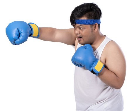 portrait of fat young boxer warms up