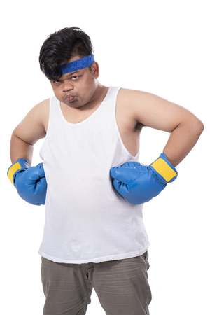 portrait of young man with boxing gloves and mouth guard