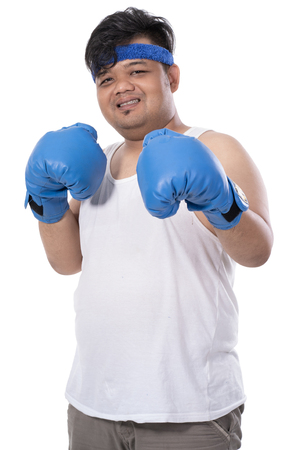 portrait of young man pose relaxed with boxing gloves