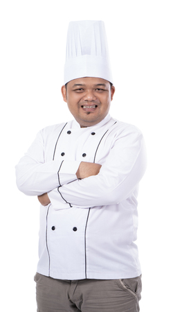 portrait of young asian chef smile and pose crossed hands look at the camera 版權商用圖片