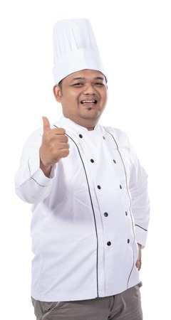 portrait of young asian chef smile while hand thumb up