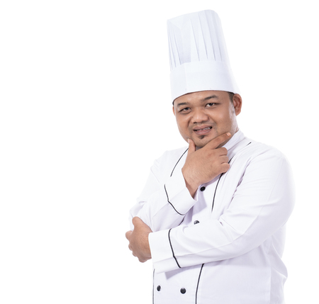 portrait of young male chef standing confident crossed hands pose look at a front of the camera