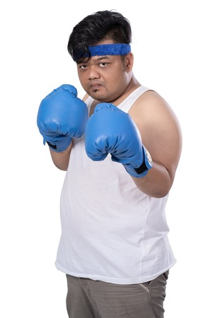 portrait of young man with boxing gloves ready to attack