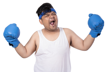 portrait of expression young man with boxing gloves hands up