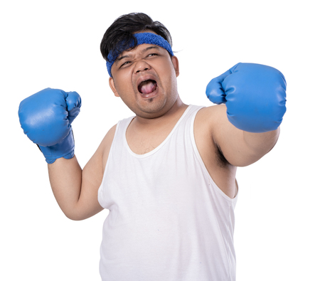 portrait of young man hit with boxing gloves