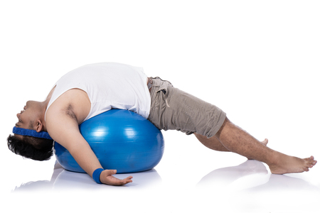 portrait of fat young men do pilates with a lying down relaxed Stok Fotoğraf
