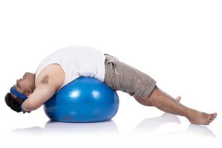 portrait of fat young men do pilates with a lying down