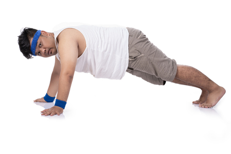 portrait of fat young man try harder doing push up