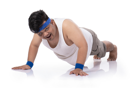 portrait of fat young man try harder doing push up Stok Fotoğraf - 115800745