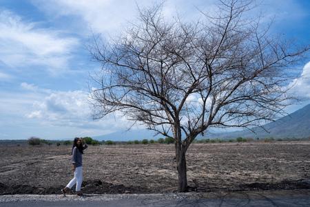 woman in dry landscape savanna