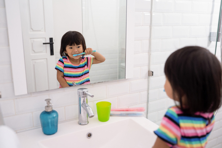 toddler independently brush her own teeth