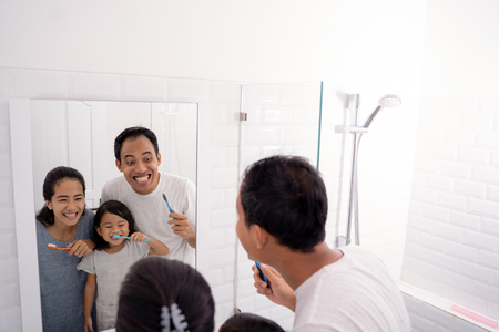 arent with daughter brush teeth in the bathroom Stock Photo