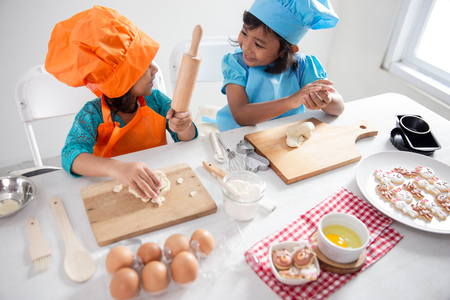 two girls toddler learn cooking and make some dough