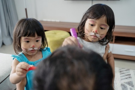 girl do some face painting to daddy Stock Photo