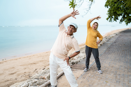muslim senior couple doing stretching and exercising outdoor