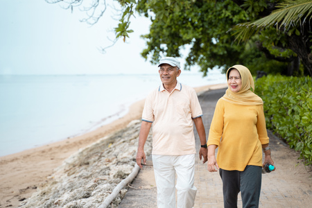 senior asian couple walking and exercising
