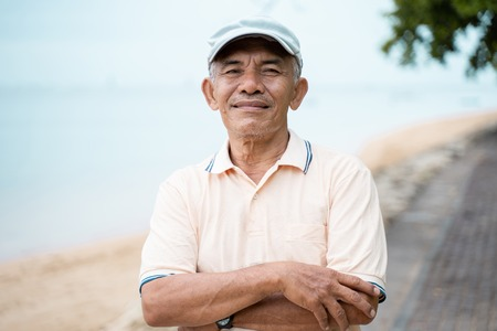 asian senior male smiling to camera