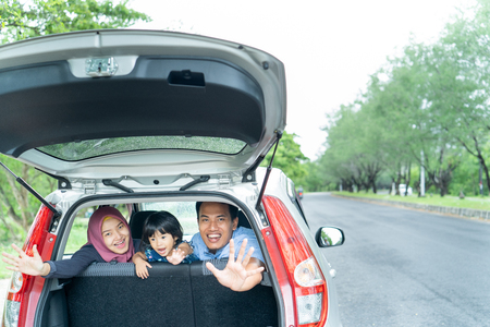 Moslem happy family smile and laugh in car