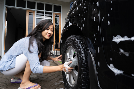 woman cleaning up her car