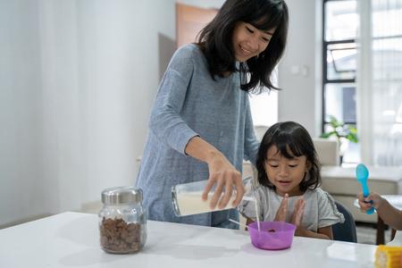 happy asian children having breakfast