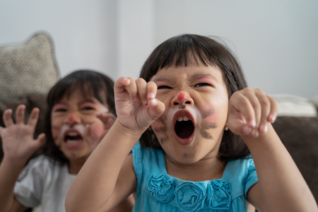 asian kids having their faces painted