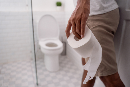 hand holding toilet paper before using it Stock Photo