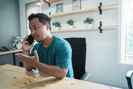 portrait of asian businessman make a call and talking about new project Stock Photo