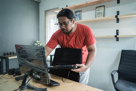 portrait of technician fix a computer Фото со стока