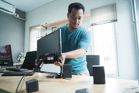 portrait of technician fix a monitor