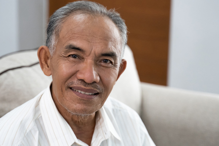 portrait of asian oldman smile when look at the camera