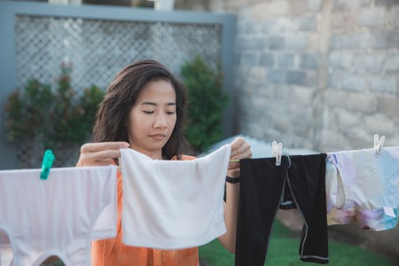 portrait of a housewife drying clothes in the morning