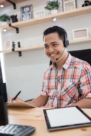 asian tele marketing on duty talk via phone