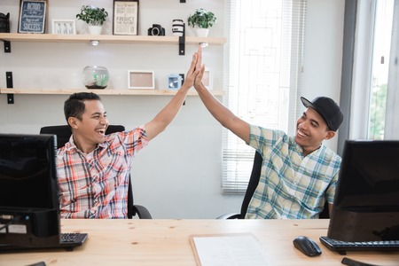 business partner highfive success in the office