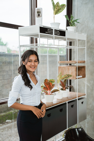 businesswoman standing in front the shelves