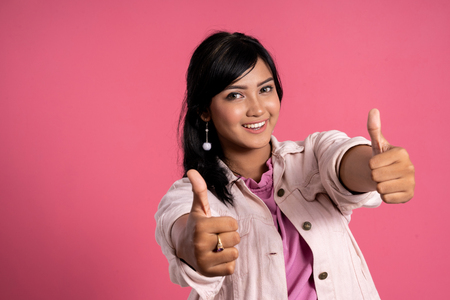 asian woman showing thumb up