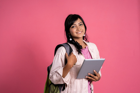 attractive asian female student holding tablet pc