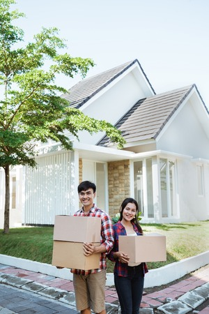 asian couple with cardboard box in the house Stock Photo