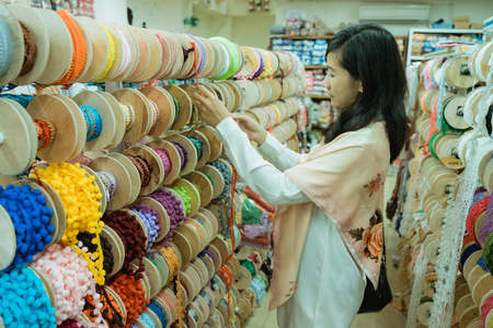 asian woman shopping some fabric decoration Stock Photo