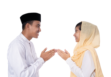 man and woman greeting in muslim traditional way