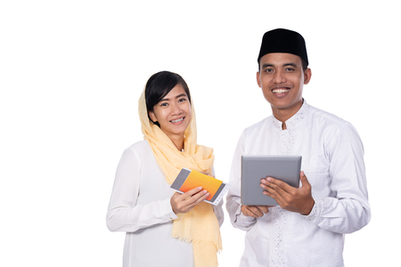 asian young couple muslim using tablet pc